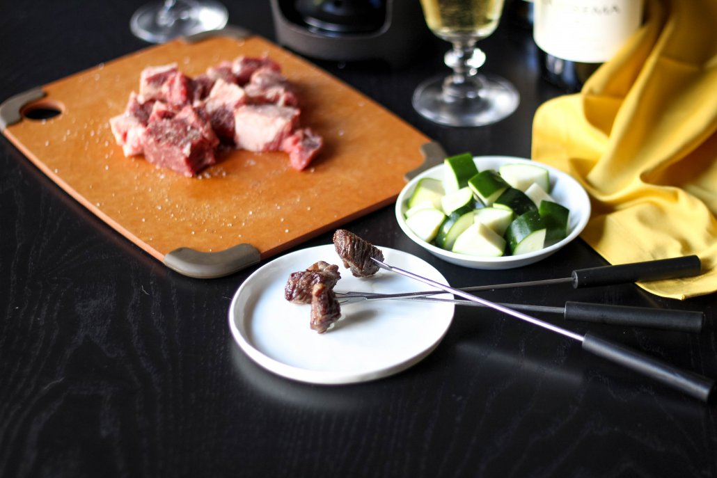 Preparing fondue with meat