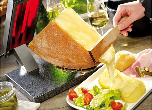 Swiss raclette fondue dish service